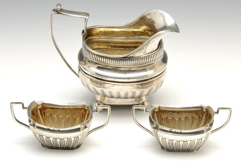 A George III silver cream jug & Edwardian silver salts.