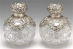A late Victorian pair of silver mounted glass perfume