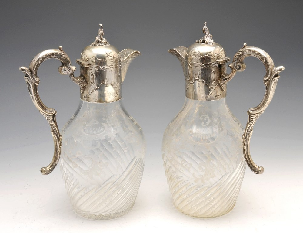 A turn of the century pair of German glass claret jugs.