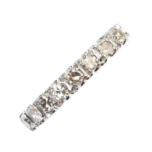 A diamond eight-stone half-circle eternity ring.
