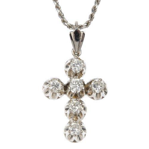 A diamond cross pendant.