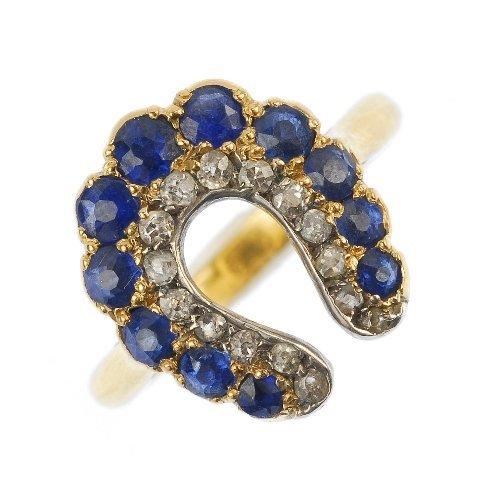 A late 19th century gold sapphire and diamond horseshoe