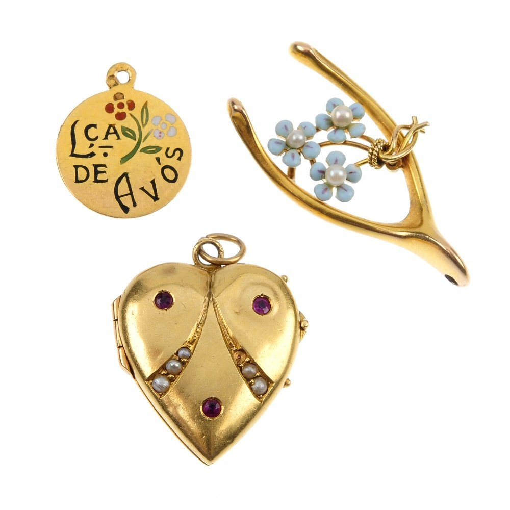 A selection of three early 20th century gold pendants.
