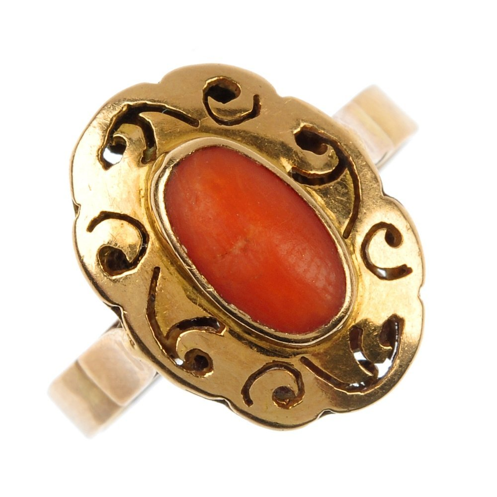 A coral single-stone ring.