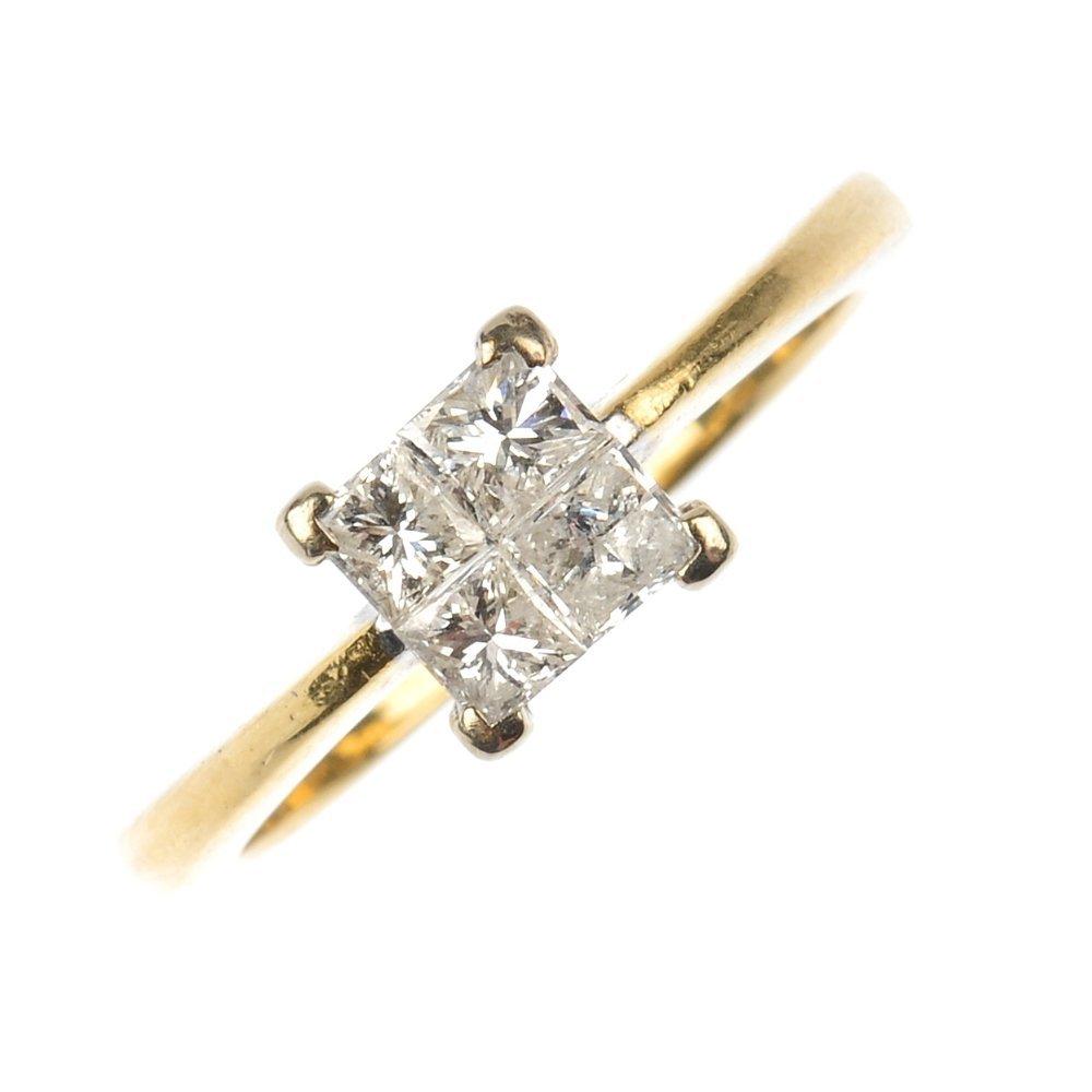An 18ct gold diamond four-stone ring.