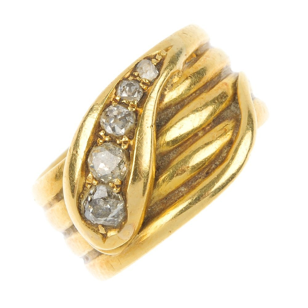 An early 20th century 18ct gold diamond snake ring.