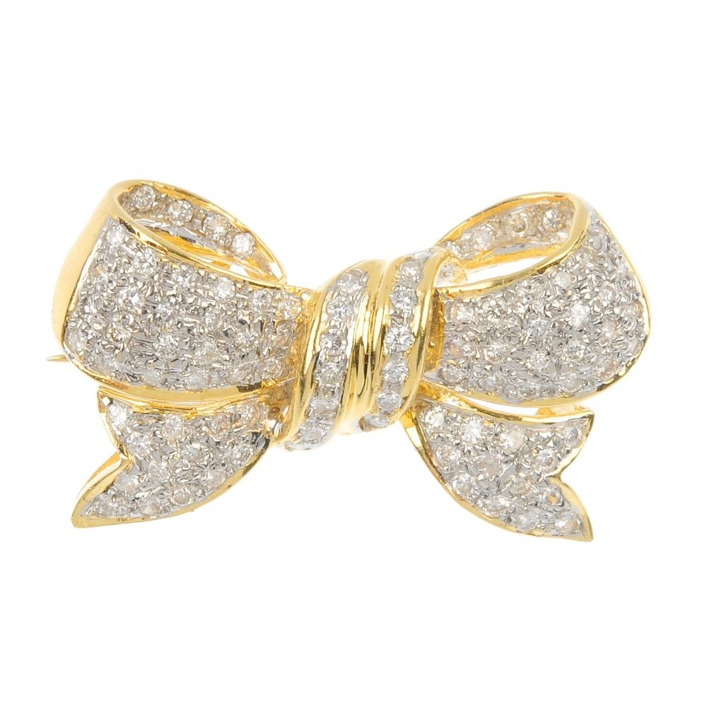 A diamond bow brooch.