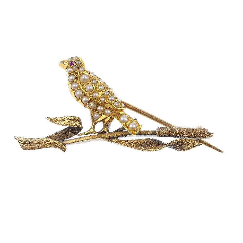 An early 20th century gold split pearl bird brooch.