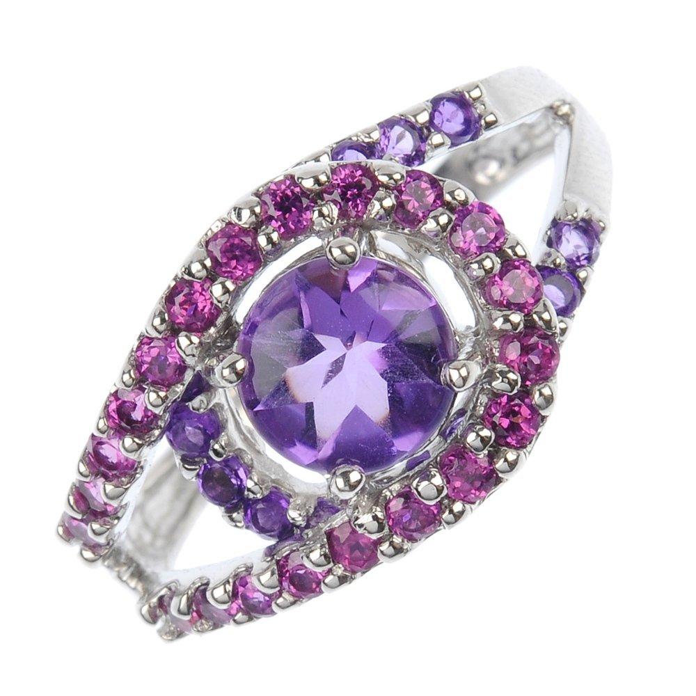 A gem-set dress ring.