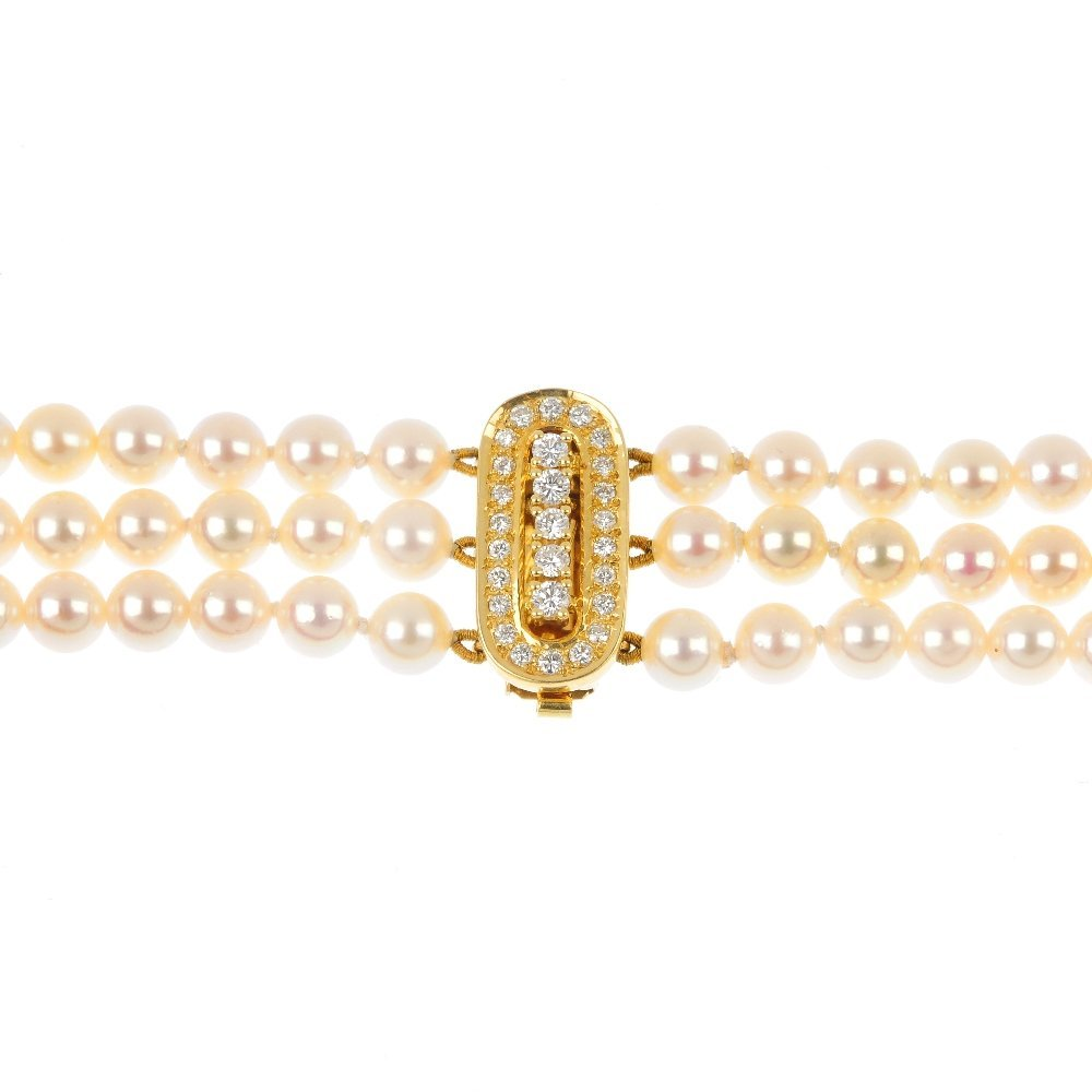 A cultured pearl three-row necklace with diamond clasp.