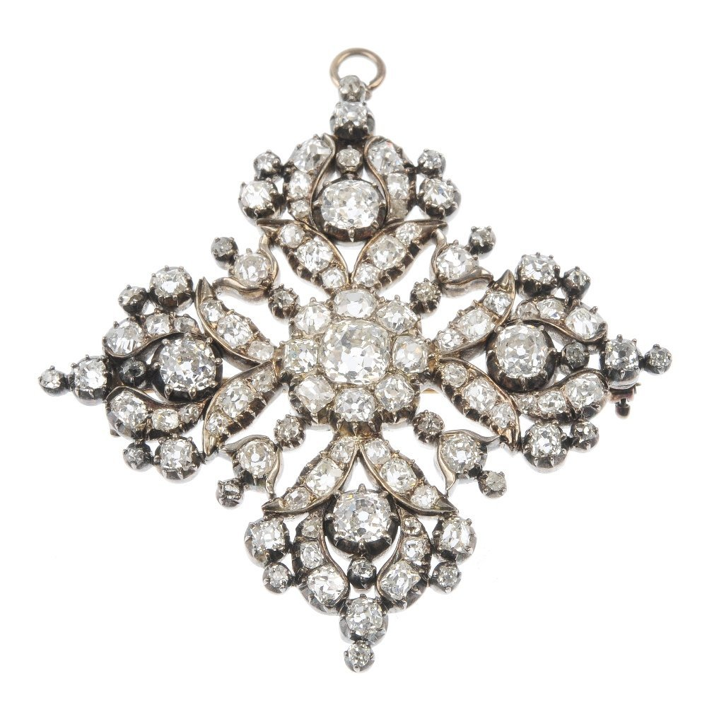 A late 19th century silver and gold diamond cluster bro