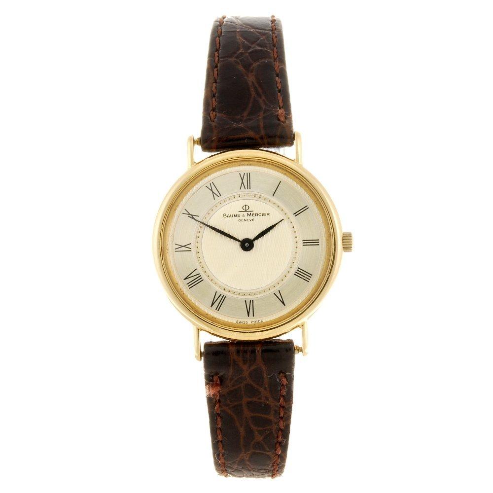 A quartz lady's 18k gold Baume & Mercier wrist watch.