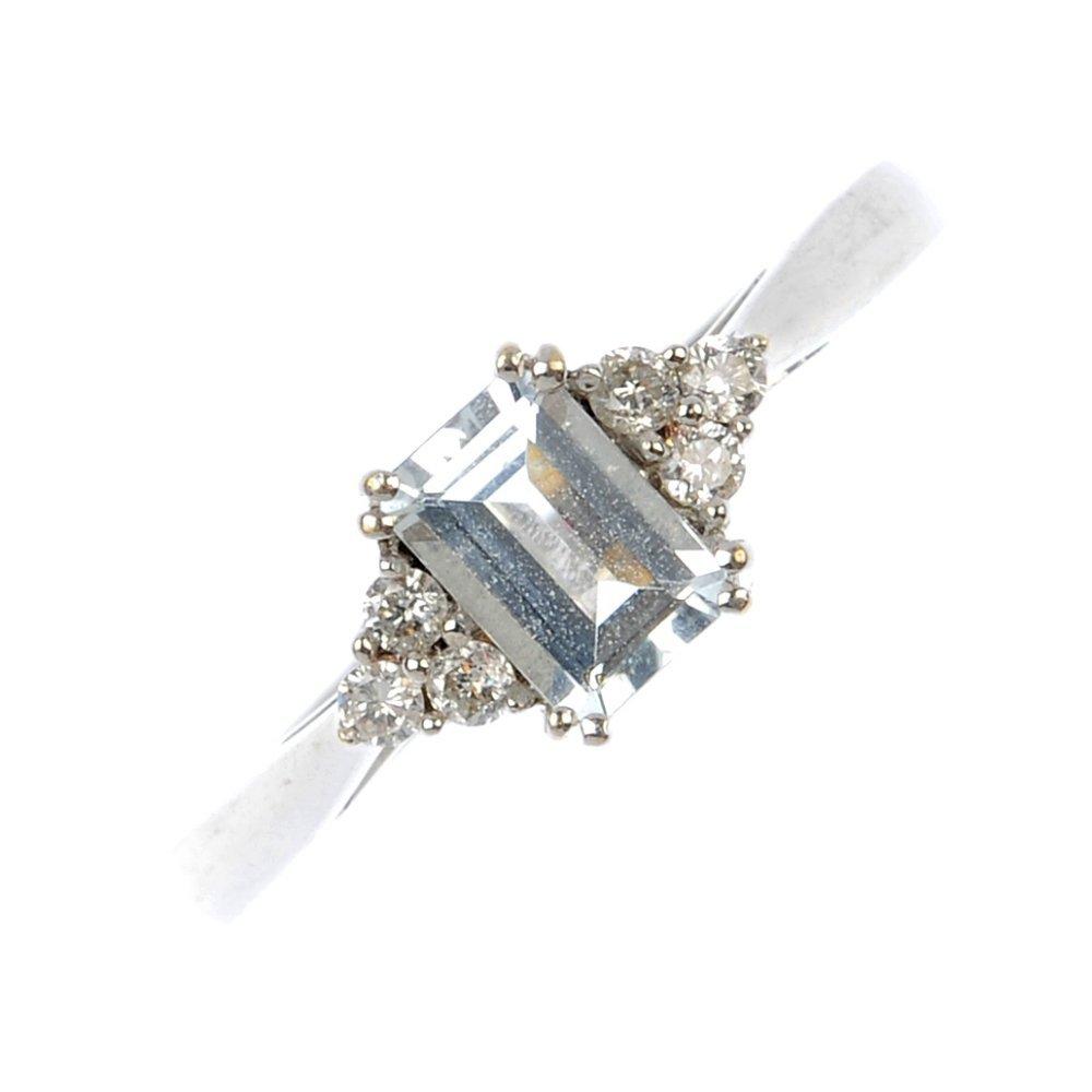 A 9ct gold aquamarine and diamond dress ring.