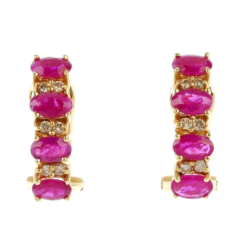 A pair of 18ct gold ruby and diamond ear studs.