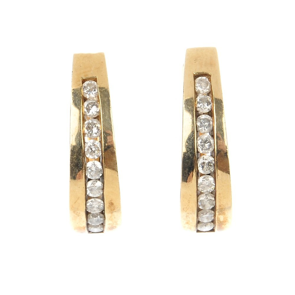 A pair of 9ct gold diamond ear hoops.