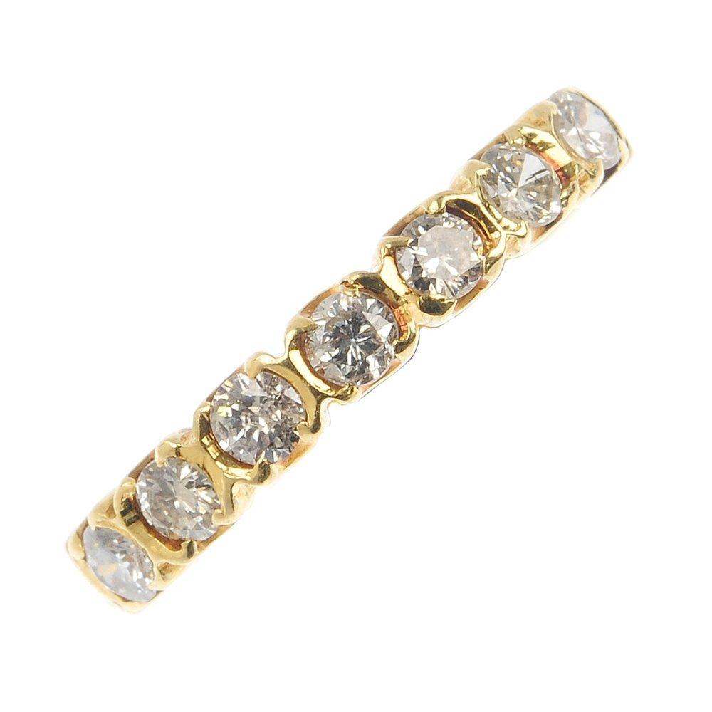 An 18ct gold diamond half-circle et ring.