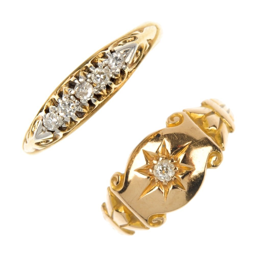 Two early 20th century 18ct gold diamond dress rings.