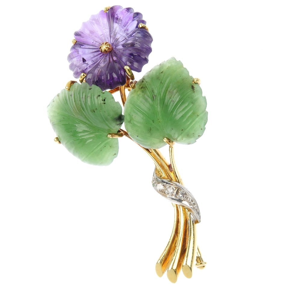 An amethyst and nephrite jade floral brooch.