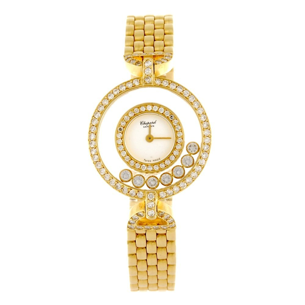 An 18k gold quartz lady's Chopard Happy Diamonds bracel
