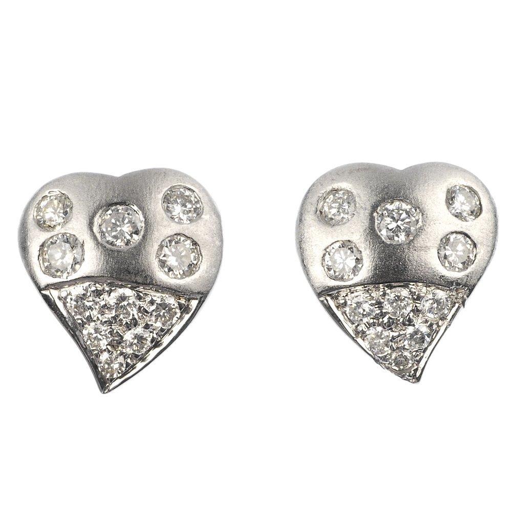 A pair of diamond ear studs.