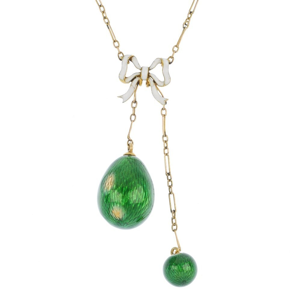 An early 20th century 9ct gold enamel egg pendant.