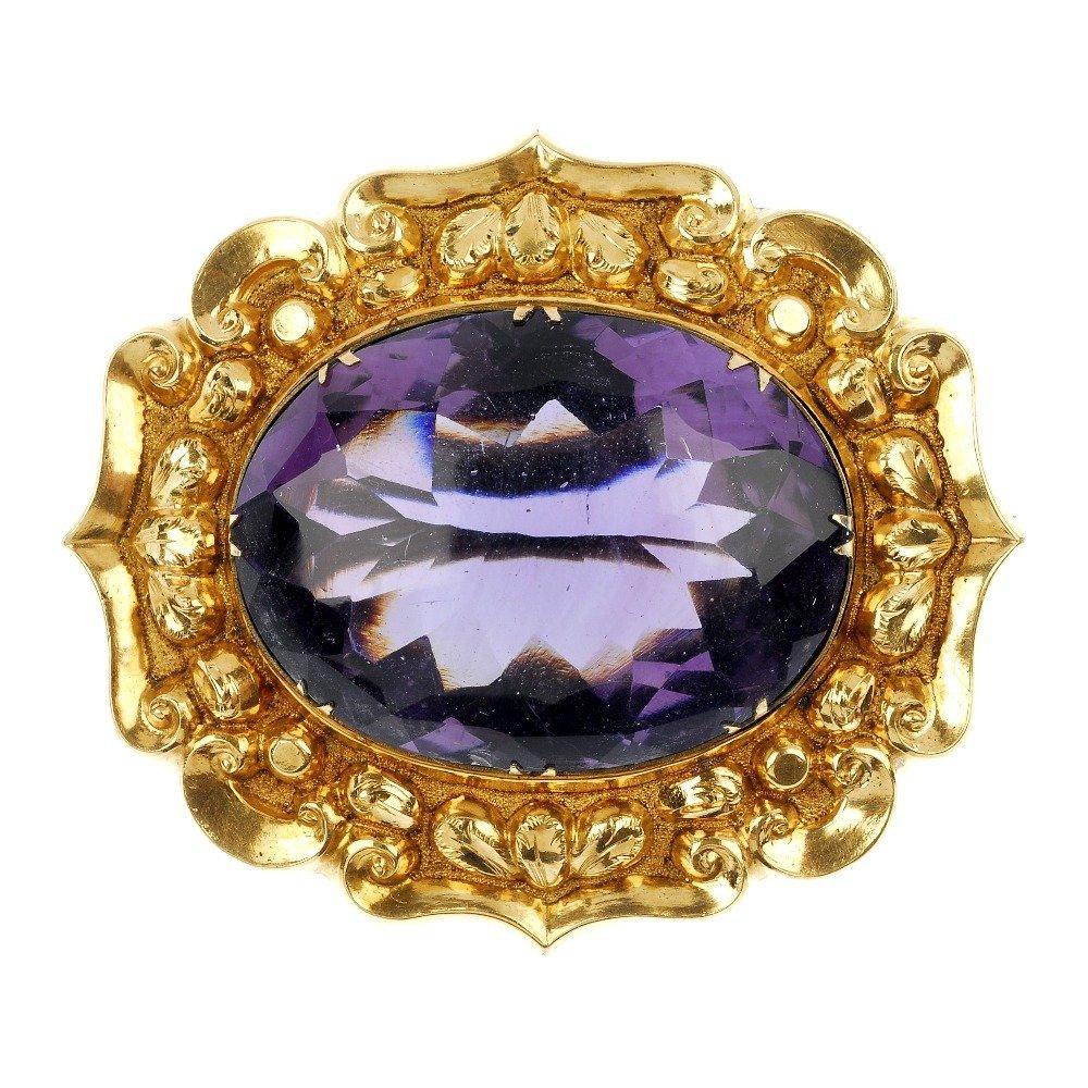 A late 19th century gold amethyst brooch.