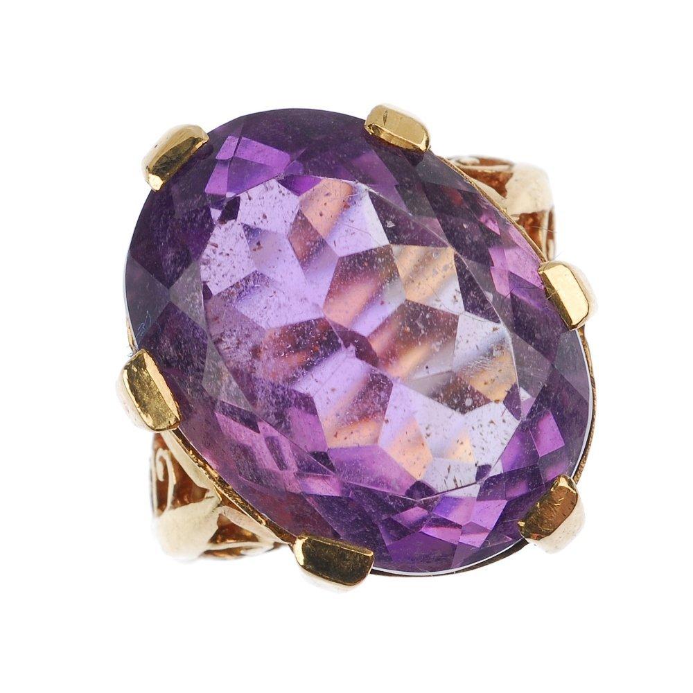 An amethyst single-stone ring.