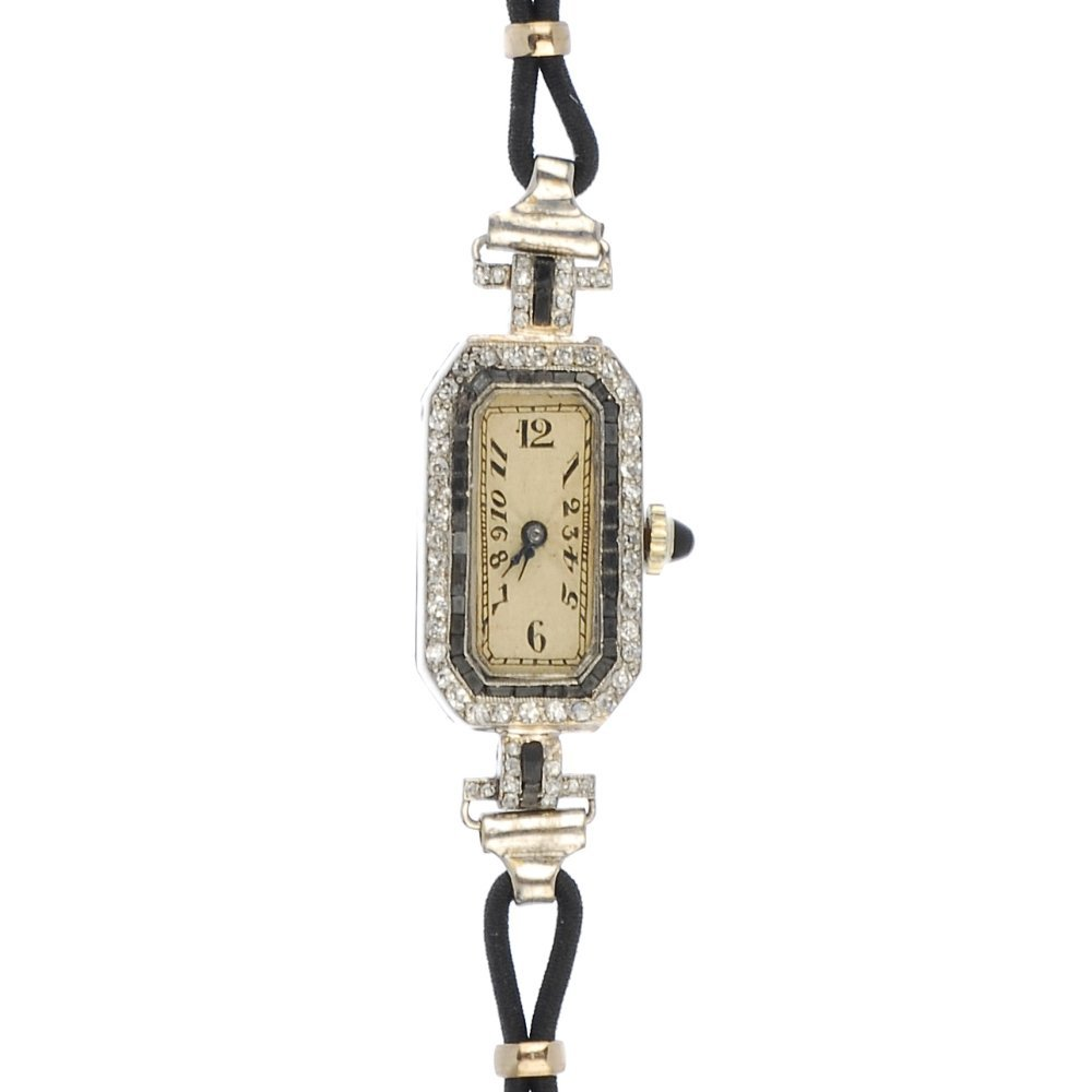 An Art Deco platinum diamond and gem cocktail watch.