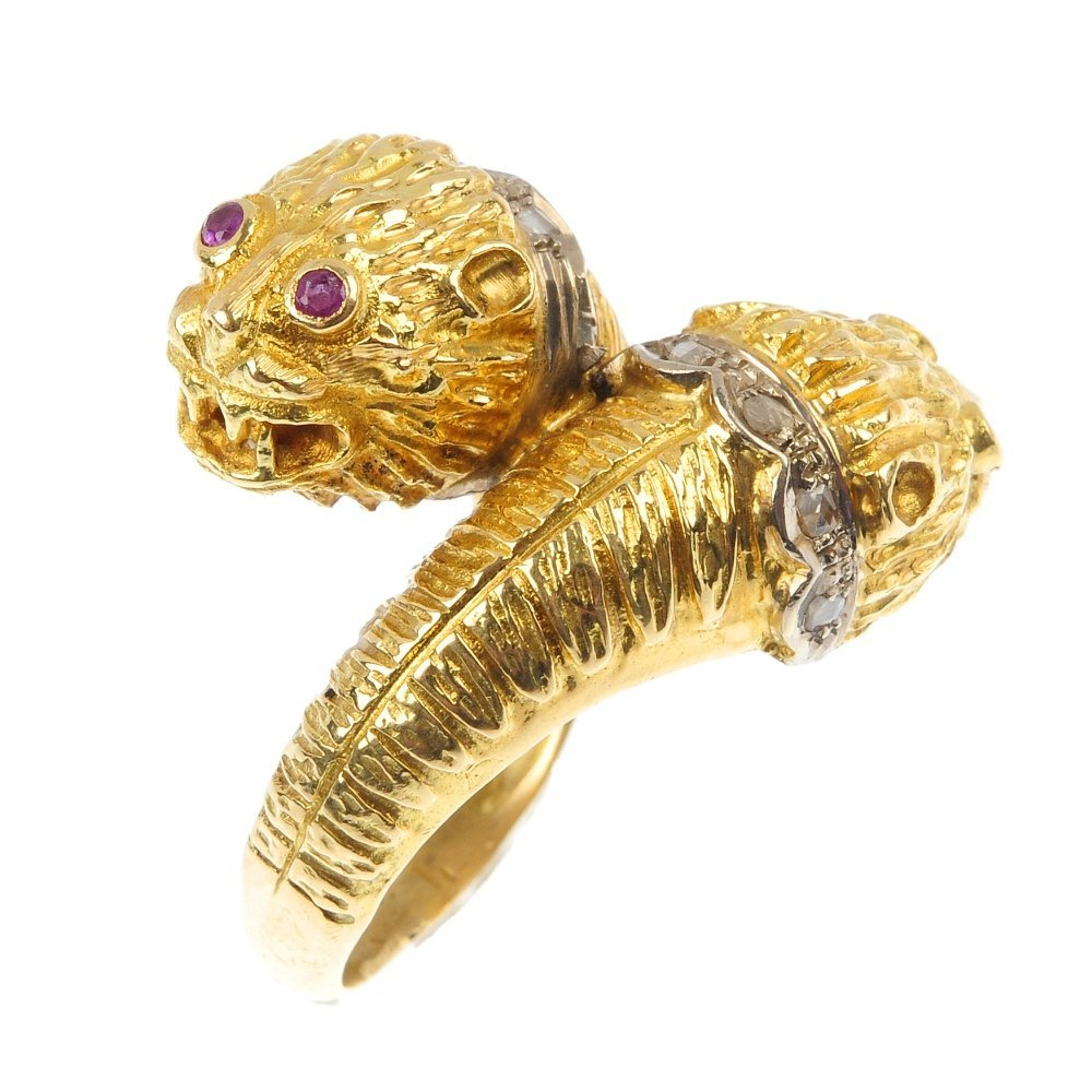 LALAOUNIS - a diamond and ruby lion head ring.
