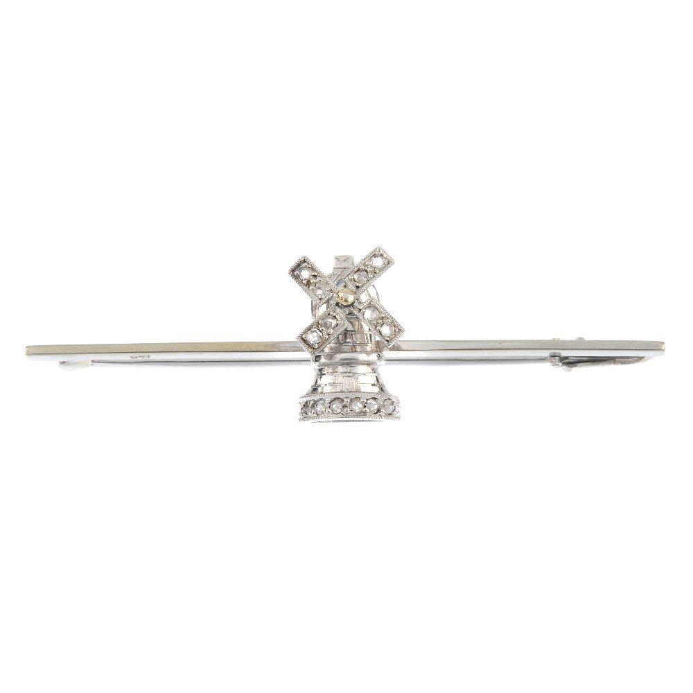 A diamond windmill brooch.