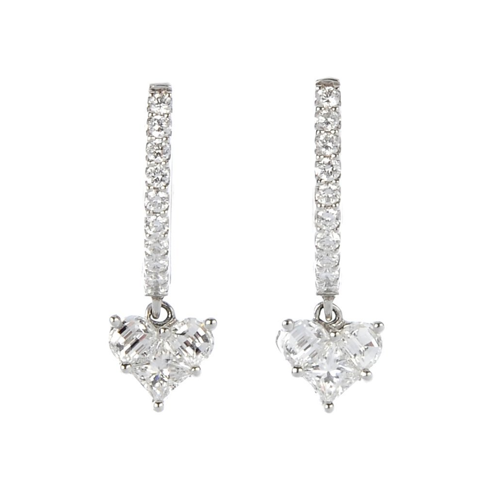 LADY HEART - A pair of 18ct gold diamond earrings.