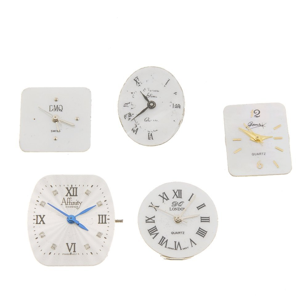 A selection of watch movements and other parts.