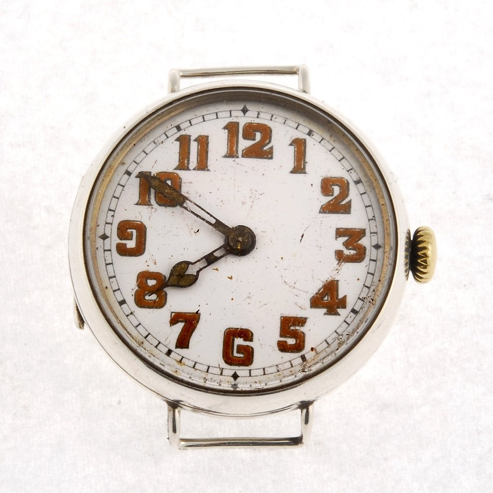 A silver manual wind trench watch head.