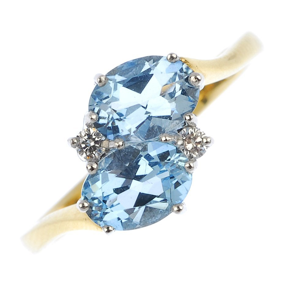 An 18ct gold aquamarine and diamond crossover ring.