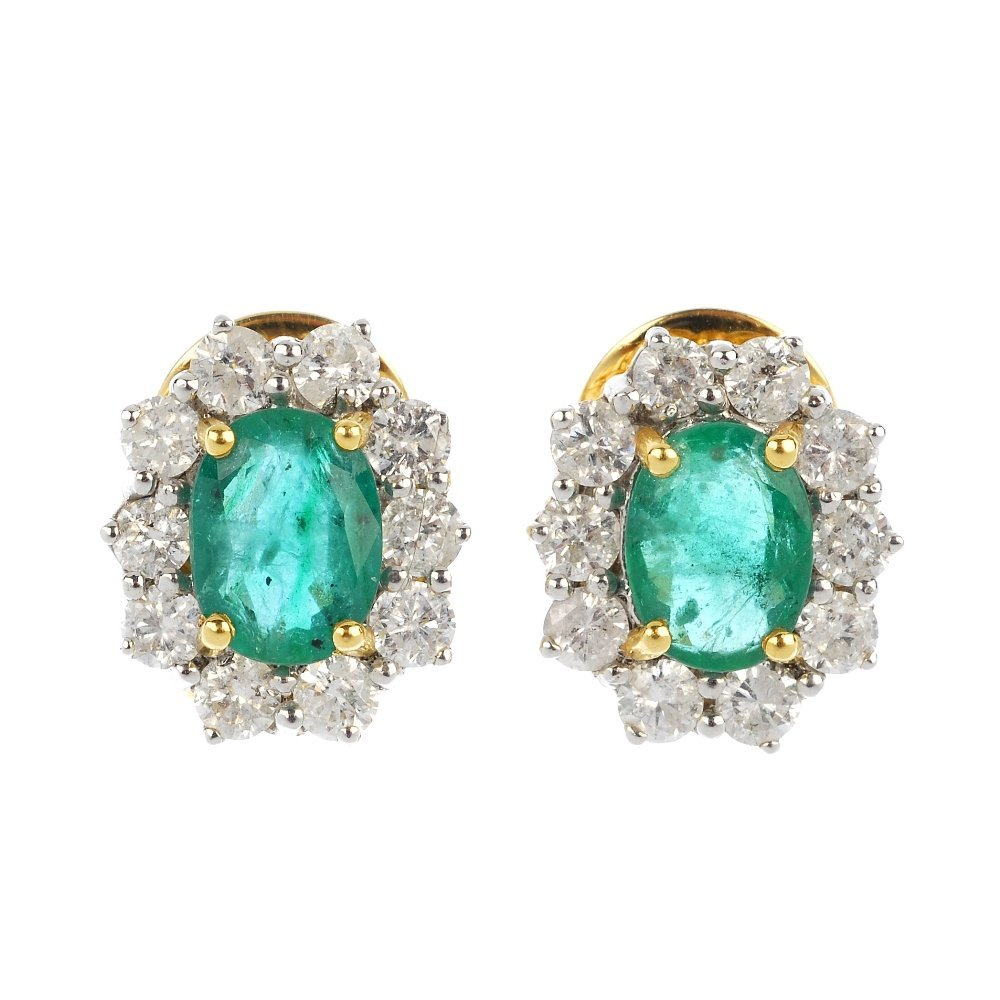 A pair of emerald and diamond cluster ear studs.