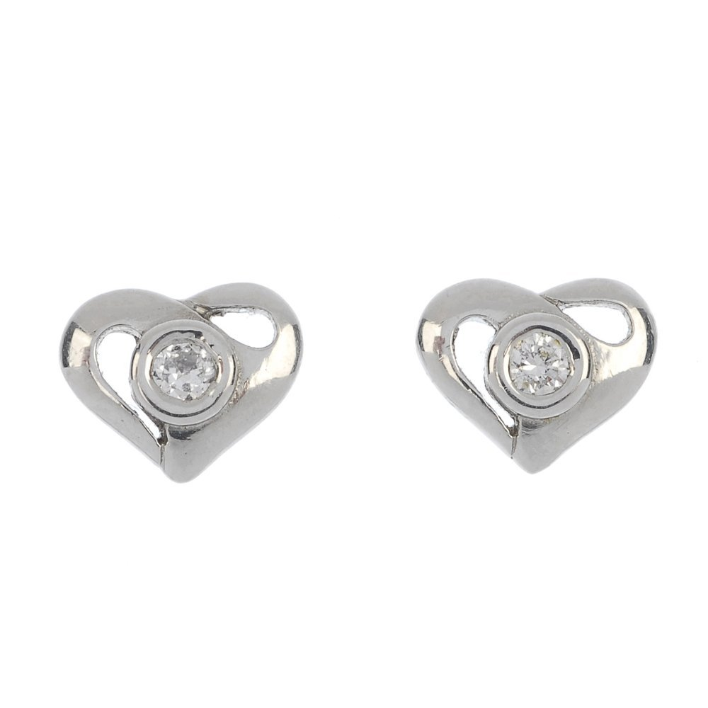 A pair of platinum diamond heart ear studs.