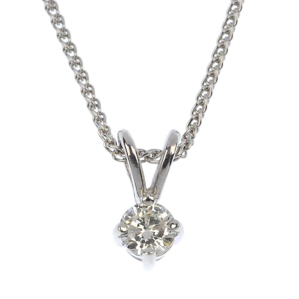 An 18ct gold diamond single-stone pendant.