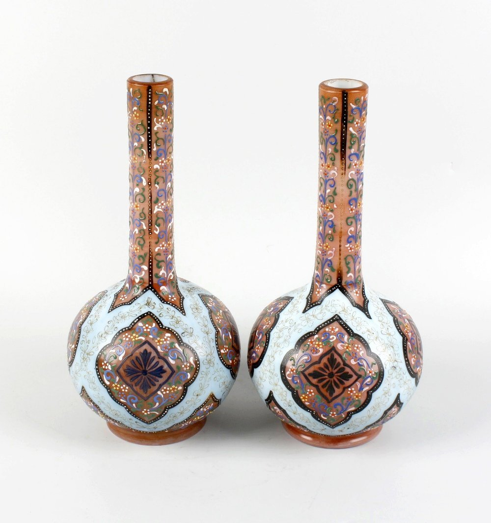 A pair of late 19th century opaque glass bottle vases