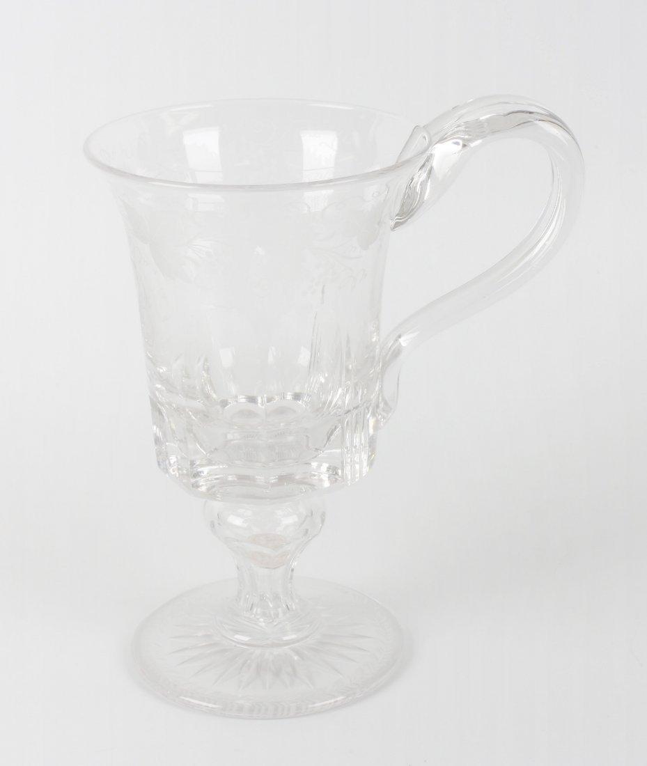A Victorian engraved glass mug