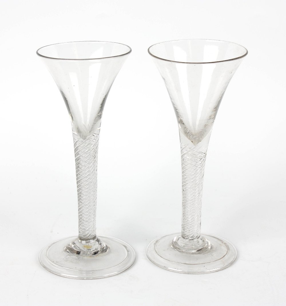 A near pair of mid 18th century cordial glasses