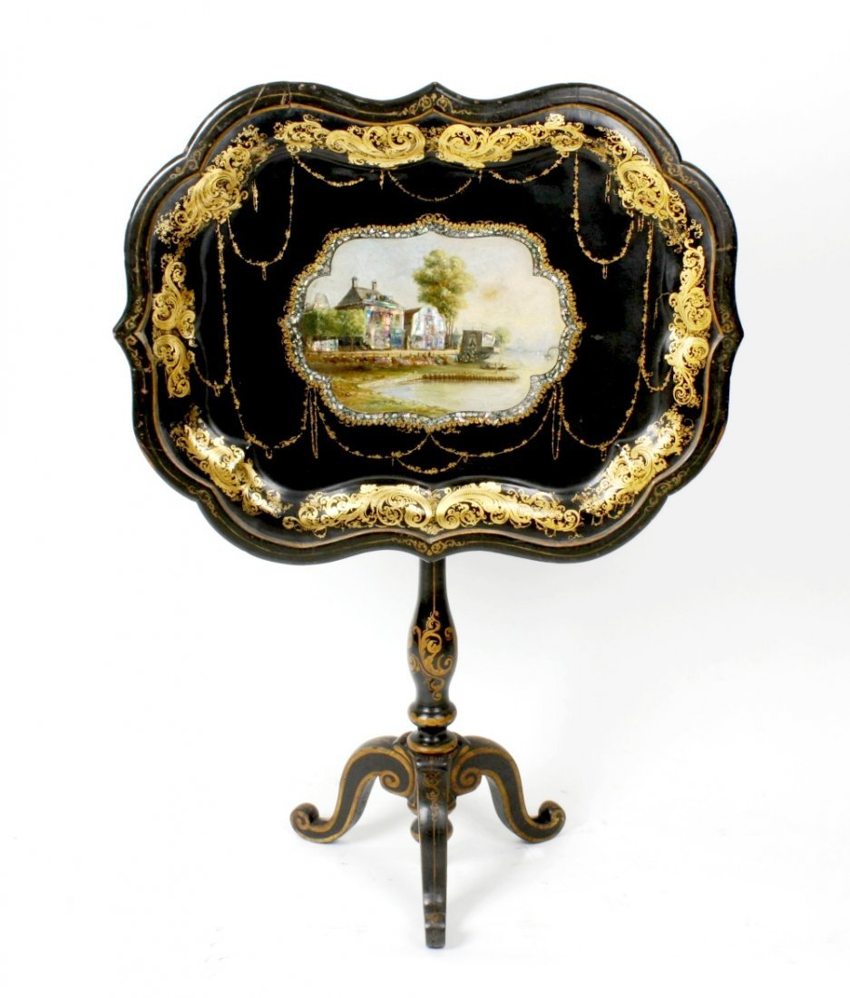 A 19th century black lacquered and papier mache snap