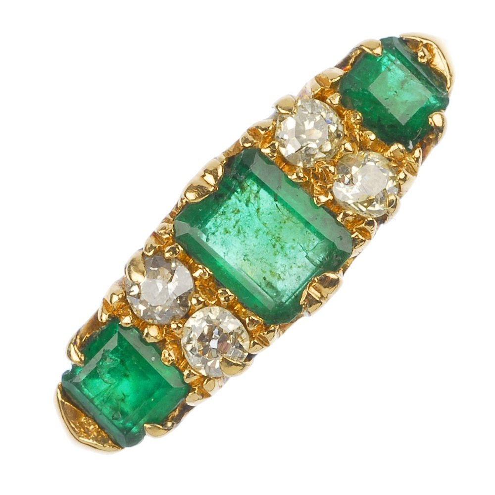 An Edwardian 18ct gold emerald and diamond seven-stone