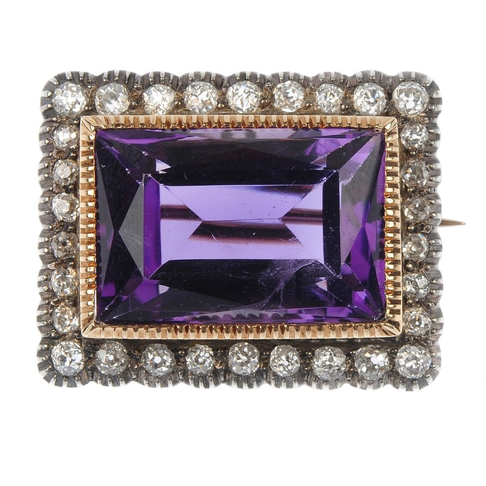 An amethyst and diamond brooch.