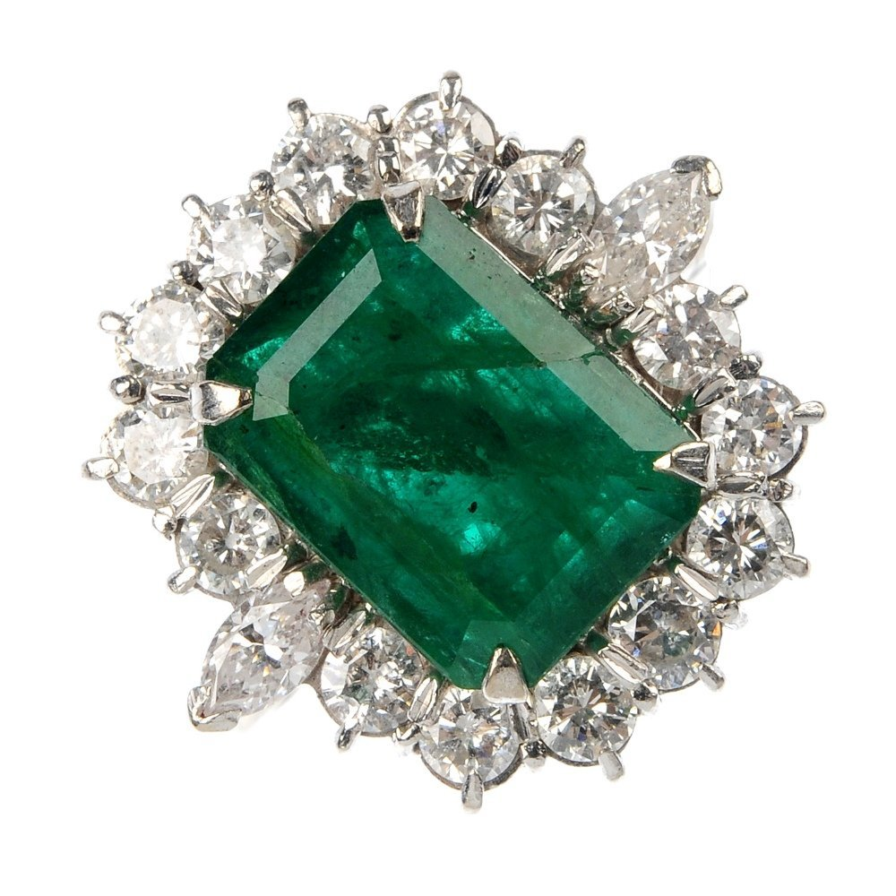 An 18ct gold emerald and diamond cluster ring.