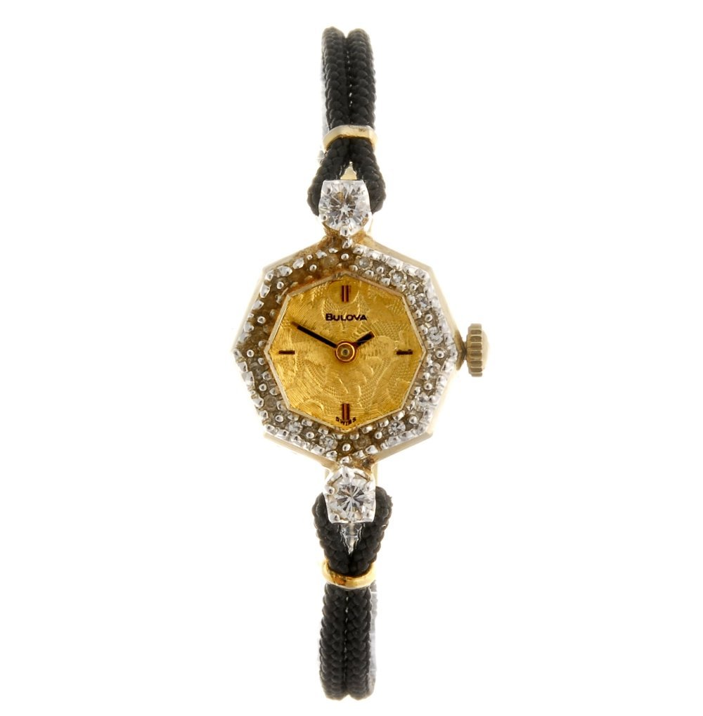 (7830) A 14k gold manual wind lady's Bulova wrist