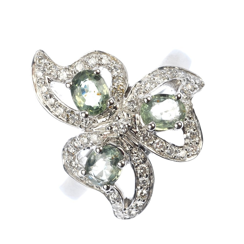 A diamond and gem-set floral ring.