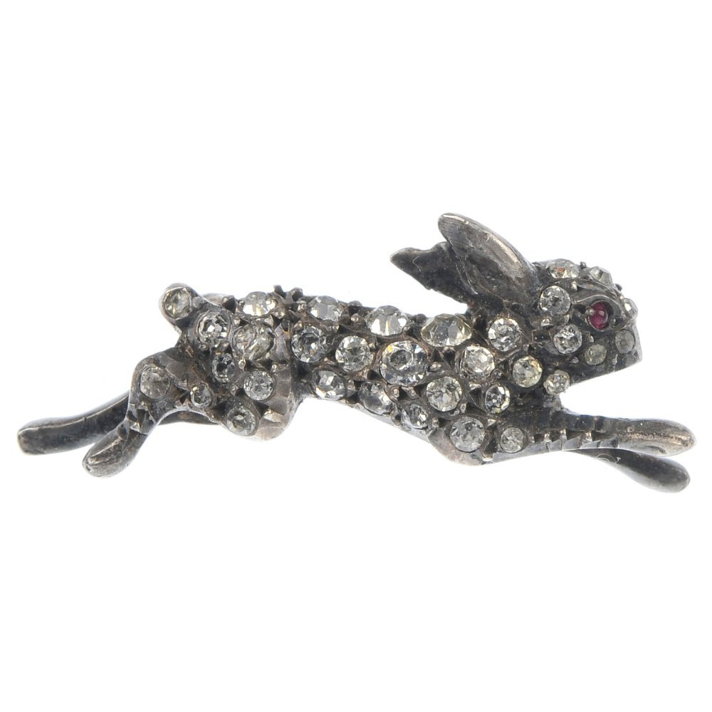 An early 20th century silver paste hare brooch.
