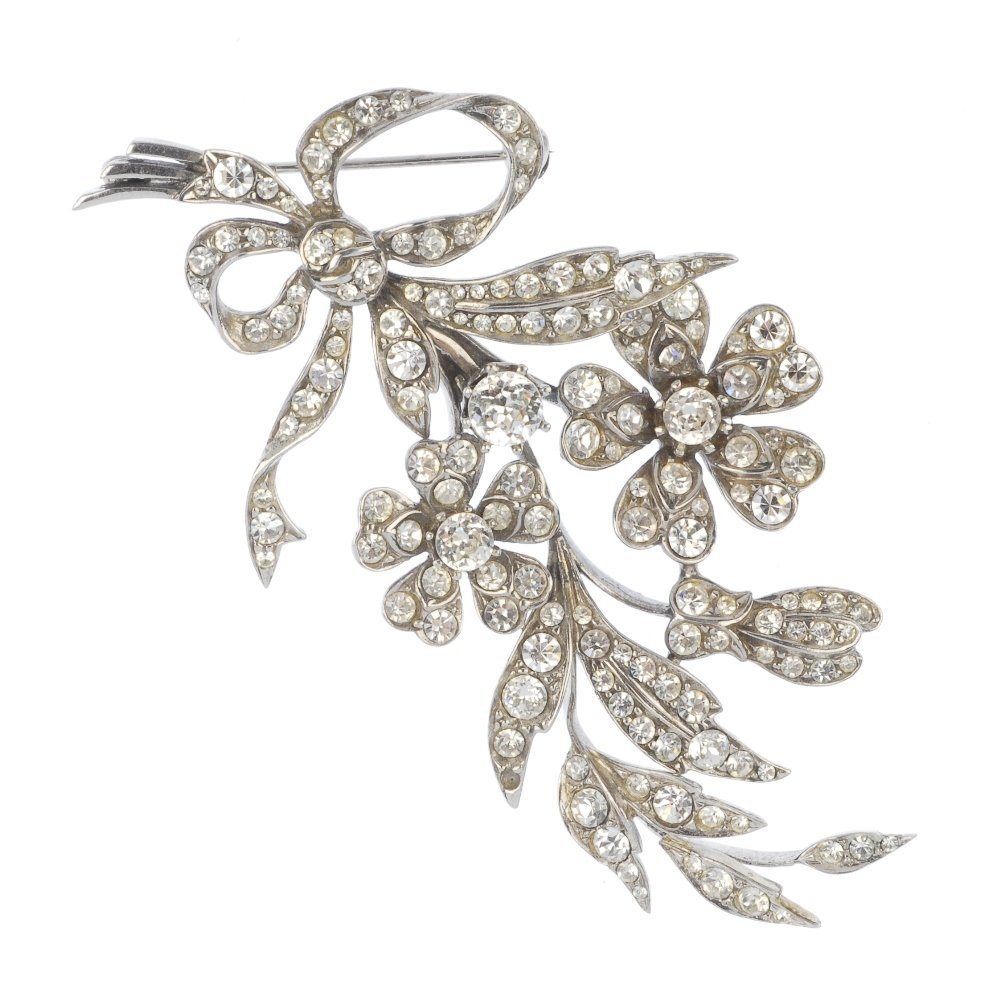 A silver paste floral brooch.