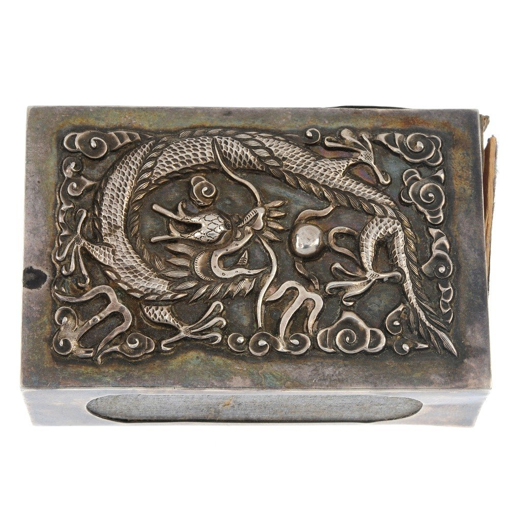 An early 20th century Chinese silver matchbox holder.