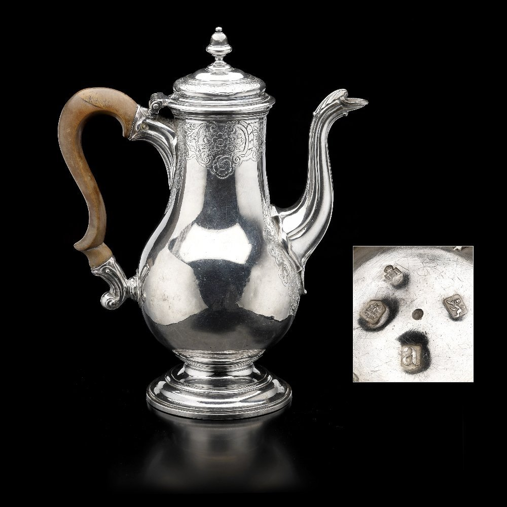 A George II silver coffee pot.